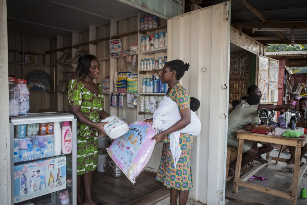 YOWE supported trader Rachela Awlimet near her baby supplies store in Odumase.